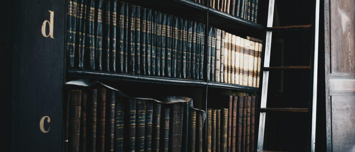 black wooden d and c bookshelf